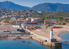 White lighthouse tower in Port of Propriano Royalty Free Stock Photography