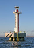 White Lighthouse tower with red stripe Stock Photos