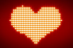 White lights forming heart over red background Stock Photos