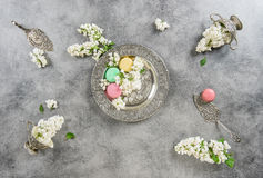 White lilac flowers macaroon cakes. Antique silver dishes Royalty Free Stock Images