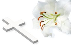 White lili and white cross Royalty Free Stock Images