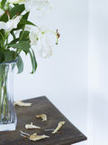 White lilies in vase on table close up Stock Photos