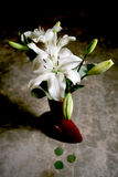 White lily bouquet. In Chinese terracotta vase Royalty Free Stock Photo
