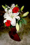 White lily bouquet. In Chinese terracotta vase Stock Photos