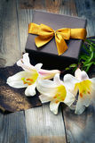 White lily with box on wooden table Stock Image