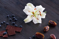 White lily with fruits and chocolate Royalty Free Stock Photo
