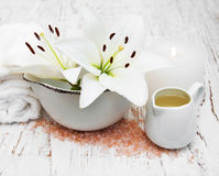 White lily, towels and sea salt Stock Photos