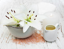 White lily, towels and sea salt Royalty Free Stock Photos