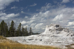 White limestone of Castle Geyser with deep blue sky, Yellowstone, Wyoming. Royalty Free Stock Image