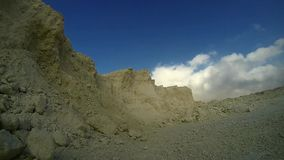 White limestone clouds in timelapse. White limestone rocks with clouds in a blue sky in timelapse stock footage