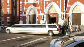 White limo before church Stock Photos
