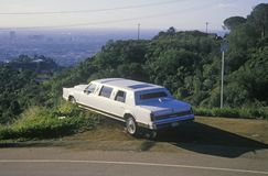 A white limo parked on Mulholland Drive, Los Angeles, California Royalty Free Stock Photo