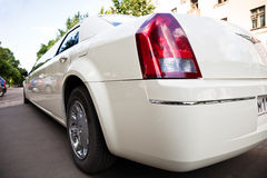 White limousine. The white stretch limousine close-up Stock Image