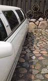 White limousine with black windows. There is a white limousine with black windows on way made from stone Stock Images