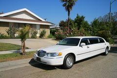 White limousine at driveway Royalty Free Stock Photography