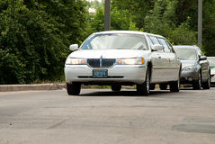 White Lincoln Town Car limousine at the city street Stock Images