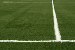 White line. A white line on an green sports field Stock Photography