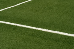 White line. A white line on an green sports field Royalty Free Stock Photos