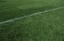 White line. Football stadium with green grass and white line Stock Image