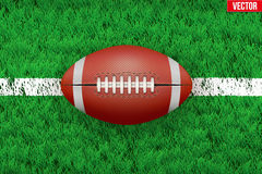White line and american football ball on Sport grass field Royalty Free Stock Photography