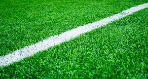 White line on artifact grass sport field texture background. White line on artifact grass sport field for texture background Royalty Free Stock Images