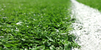White line on artificial turf Stock Images