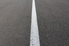 White line on asphalt. White line in the middle of a road Stock Photography