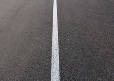 White line on asphalt. White line on a road Royalty Free Stock Image
