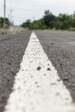 White line on asphalt road close up Stock Photos