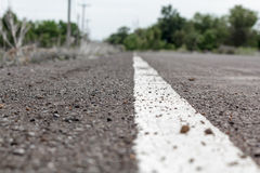 White line on asphalt road close up Royalty Free Stock Photo