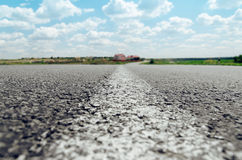 White line on asphalt road close up Stock Image