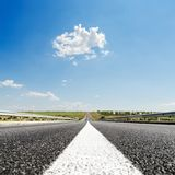 white line on asphalt road closeup and blue sky Royalty Free Stock Photography