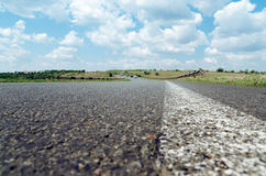 White line on asphalt road closeup Royalty Free Stock Images