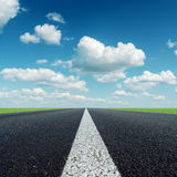 White line on asphalt road and clouds Royalty Free Stock Photo