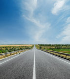 White line on asphalt road and clouds in sky Stock Photo