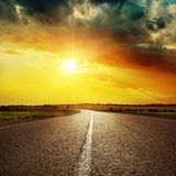 White line on asphalt road and dramatic sunset Royalty Free Stock Photos