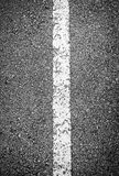 White line on black asphalt road Stock Images