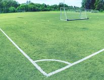 White line corner of the soccer field, pattern of green grass for football sport,. Football field, sport texture, selective focus Stock Images