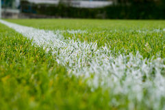 White line on a football field stock image