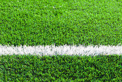 White line on the green grass Royalty Free Stock Photos