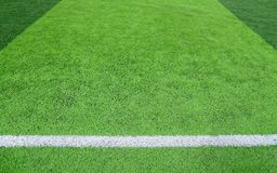 White line on a green soccer field Royalty Free Stock Image