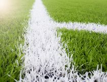 The white Line marking on the artificial green grass footbal, soccer field.  Royalty Free Stock Images
