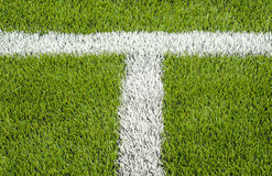 The white Line marking on the artificial green grass soccer field Stock Photography