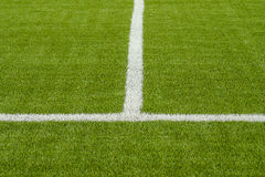 The white Line marking on the artificial green grass soccer field Stock Photos