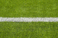 The white Line marking on the artificial green grass soccer field Royalty Free Stock Photo