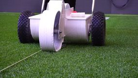 Marking football stadium field with paint. Original sound. stock footage