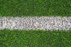 White line paint on  fake grass. Stock Photo