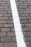 The white line on the road receding the stone. The white line on the road receding into the distance the stone Royalty Free Stock Photo