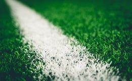 White line on soccer artifact field. White line on soccer artifact grass field Royalty Free Stock Photo