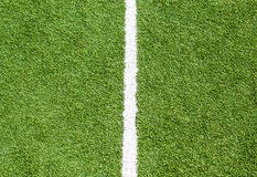 White line on soccer field grass stock image
